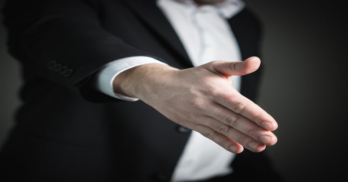 Man's hand coming forward to shake