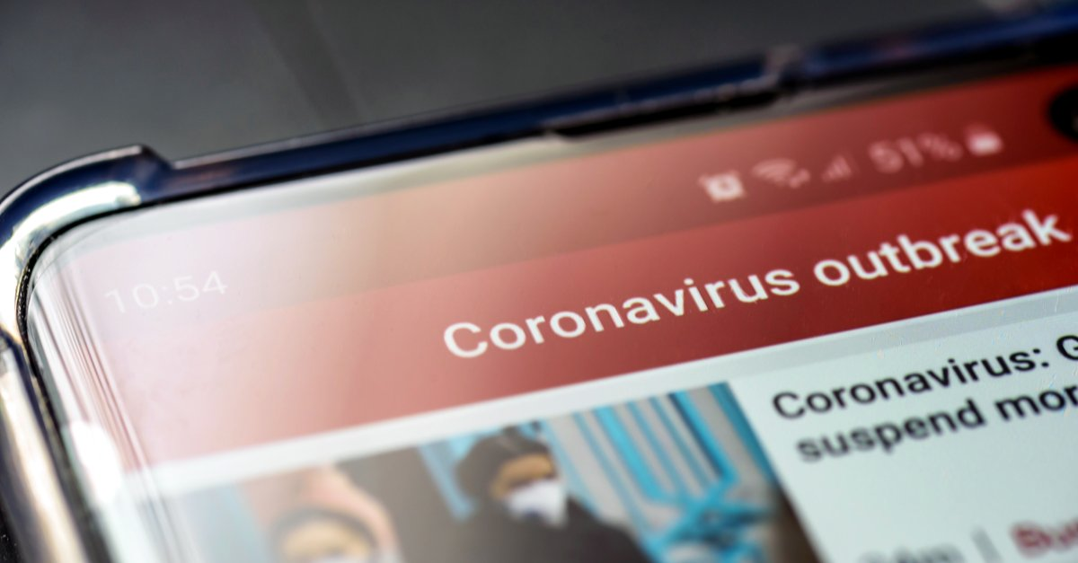 Part image of mobile phone with Coronavirus update on screen